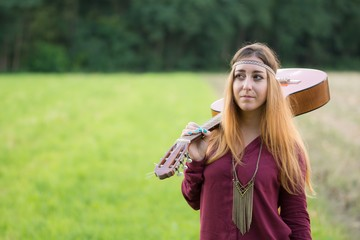 Hippie girl with a guitar