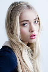 Beautiful blonde girl with long hair and green eyes