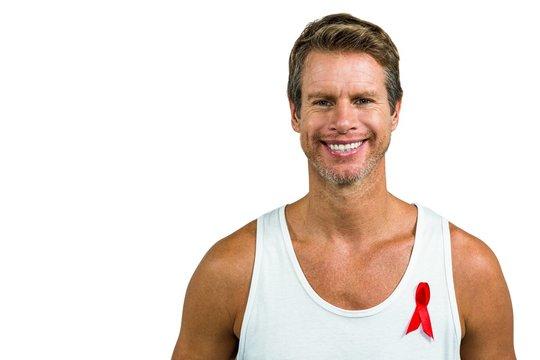 Portrait of man wearing aids ribbon on vest