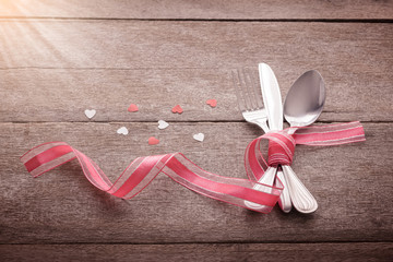 Valentines day set with silverware and heart on wooden
