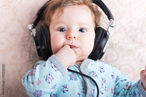 """""""Funny baby in a big headphones. Portrait of a little boy ..."""