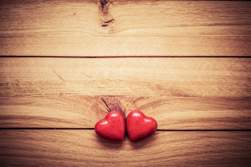 A couple of red little hearts on wood. Vintage concept of love, Valentine's Day
