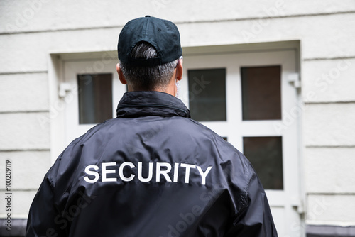 security guard standing outside building stockfotos und. Black Bedroom Furniture Sets. Home Design Ideas
