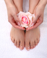 Closeup photo of a beautiful female feet with pedicure