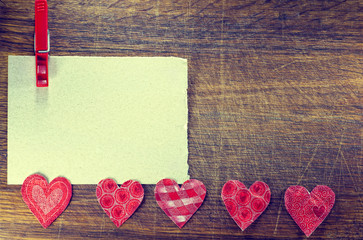 Happy Valentine's Day. Net card for congratulations, heart  on a rustic wooden background.