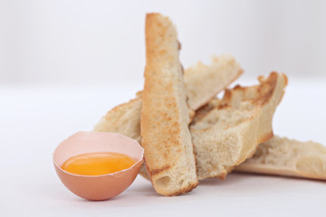 close up of an egg shell and toasted bread slices