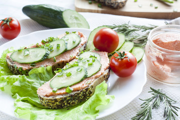 Sandwiches with fish butter, cucumber and herbs in lutucce for a snack breakfast