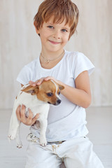 happy little boy with a little dog
