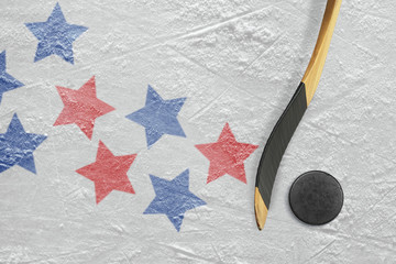 Hockey puck, stick and star