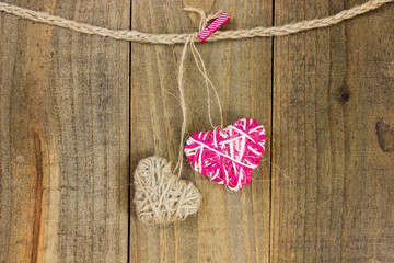 Rope hearts hanging on clothesline
