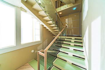 Glass and wooden stairs in modern home interior