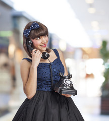 young beautiful pin up girl talking on phone