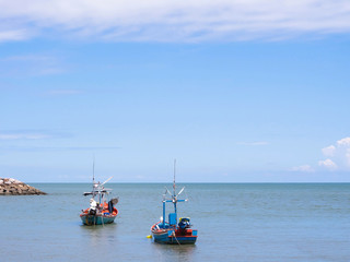 Small fishing boat floating