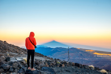 Man looking on the volcanic landscape
