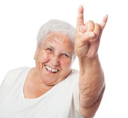 portrait of a senior woman doing a rock gesture