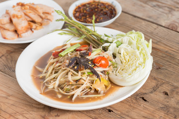 Som Tam is spicy green papaya salad, Thai food.