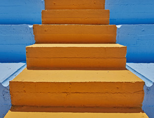 Foto op Plexiglas Trappen vibrant orange stair and blue background