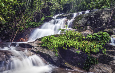 Water stream with waterfall background at tropical forest
