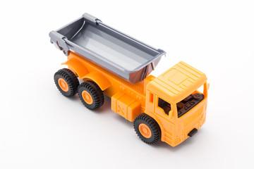 Orange truck toy construction on white background