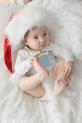Infant baby boy sleeping in Santa costume