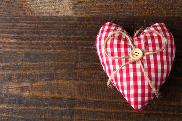 soft decorative heart on wooden brown table