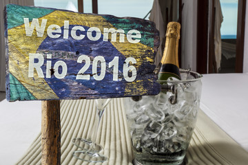 Welcome sign to Rio de Janeiro and a botle of chmpagne