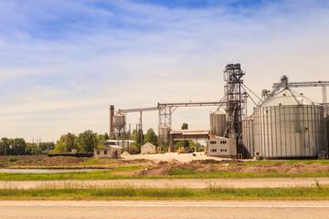 factory yard metal tank of modern silo in countryside