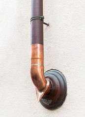 Outer copper water pipe on the wall