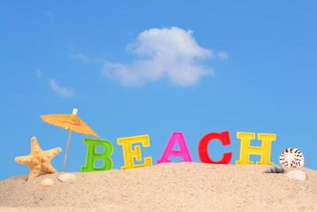 Beach letters on a beach sand