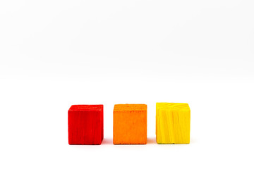 Three colored cubes isolated on white background