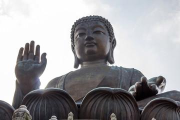 Tian Tan Buddha (the Big Buddha) is a large bronze statue of a Sakyamuni Buddha and located at Ngong Ping Lantau Island in Hong Kong.