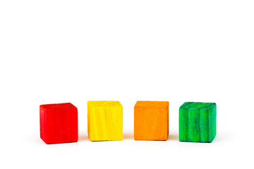 Four colored cubes isolated on white background