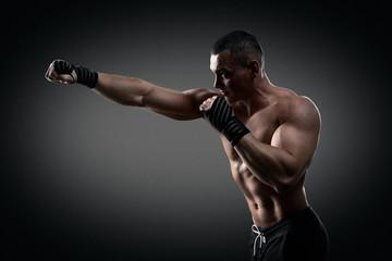 Fighter boxer on black background