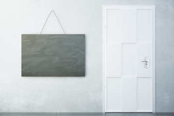 Concrete wall with a sign in the style of a chalk board and a wh