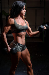 Very fit woman exercising at a gym