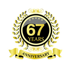 67 anniversary with glossy golden wreath and ribbon