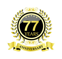 77 anniversary with glossy golden wreath and ribbon