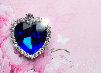 blue crystal heart on pink background
