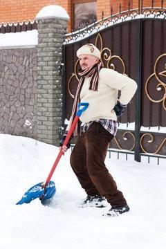 man clears snow