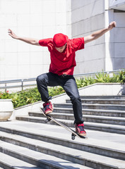 Skateboarder doing a skateboard jumping trick from stairs