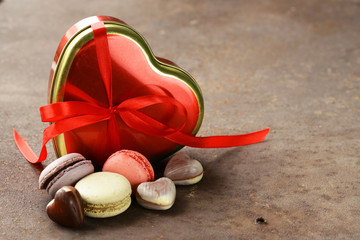 Heart box of chocolates and a macaroon for the holiday Valentines Day