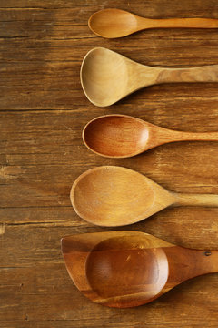 empty wooden spoons on an old grungy background