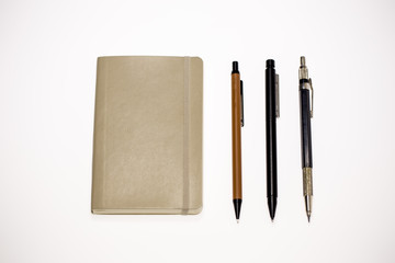 A Notebook and Three Pens