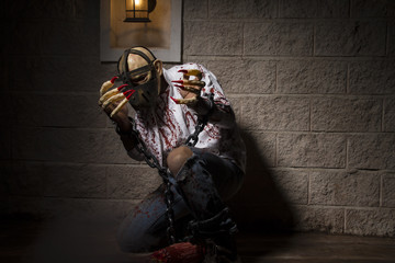 evil, Man chained with blood and knife, has a severed leg blood