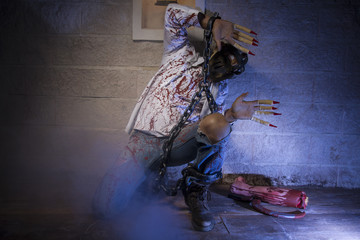 fear, Man chained with blood and knife, has a severed leg blood