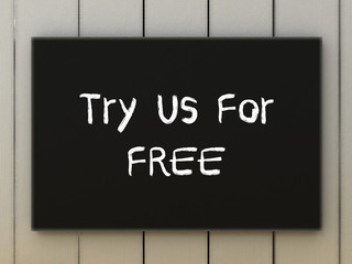 Try us for free on black board. Business concept.