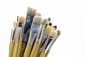 Different paintbrushes on white background