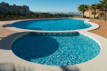 View of the swimming pool in the urbanization Altorreal. Region of Murcia. Spain
