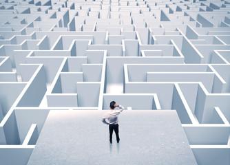 Fototapeta Businessman staring at infinite maze obraz