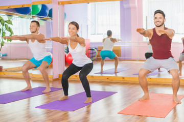 Young people lead a healthy lifestyle, exercise at fitness room